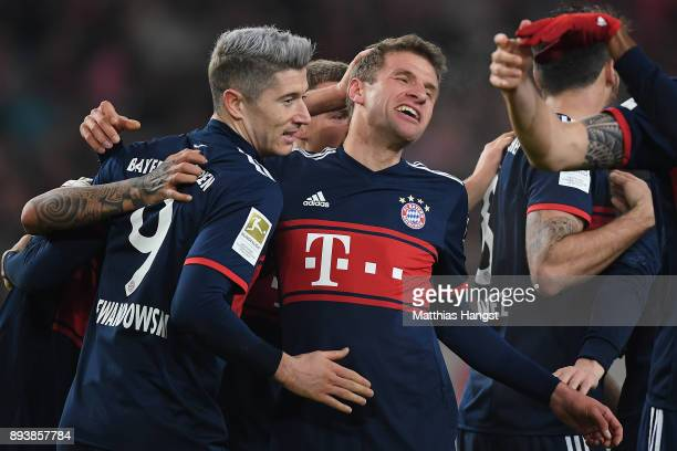 Thomas Mueller of Bayern Muenchen celebrates with his team mates after he scored a goal to make it 01 during the Bundesliga match between VfB...