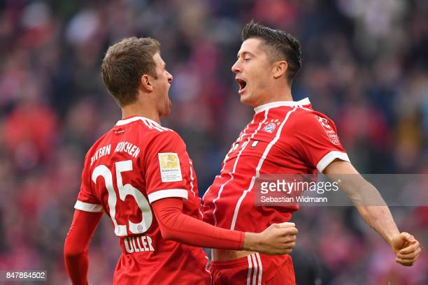 Thomas Mueller of Bayern Muenchen celebrates with Robert Lewandowski of Bayern Muenchen after Lewandowski scored his teams third goal to make it 30...