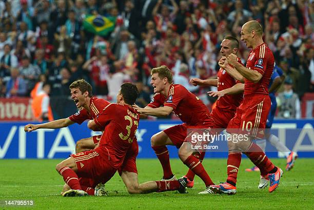 Thomas Mueller of Bayern Muenchen celebrates with team mates after scoring the opening goal during UEFA Champions League Final between FC Bayern...
