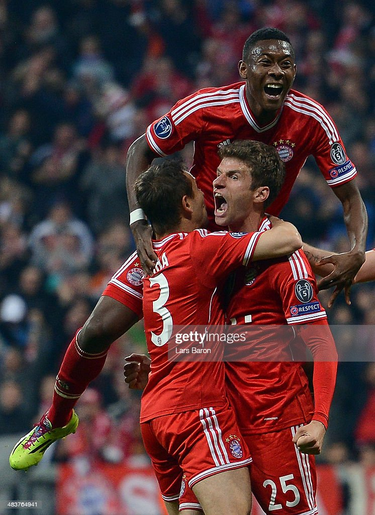 Thomas Mueller of Bayern Muenchen celebrates with team mates after scoring his teams second goal during the UEFA Champions League quarter final second leg match between FC Bayern Muenchen and Manchester United at Allianz Arena on April 9, 2014 in Munich, Germany.