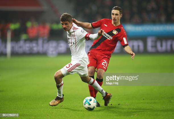Thomas Mueller of Bayern Muenchen evades Dominik Kohr of Bayer Leverkusen during the Bundesliga match between Bayer 04 Leverkusen and FC Bayern...