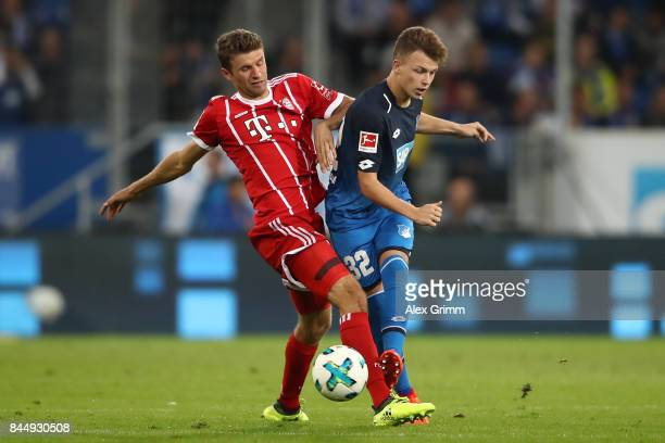 Thomas Mueller of Bayern Muenchen fights for the ball with Dennis Geiger of Hoffenheim during the Bundesliga match between TSG 1899 Hoffenheim and FC...