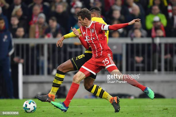 Thomas Mueller of Bayern Muenchen fights for the ball with Manuel Akanji of Dortmund during the Bundesliga match between FC Bayern Muenchen and...