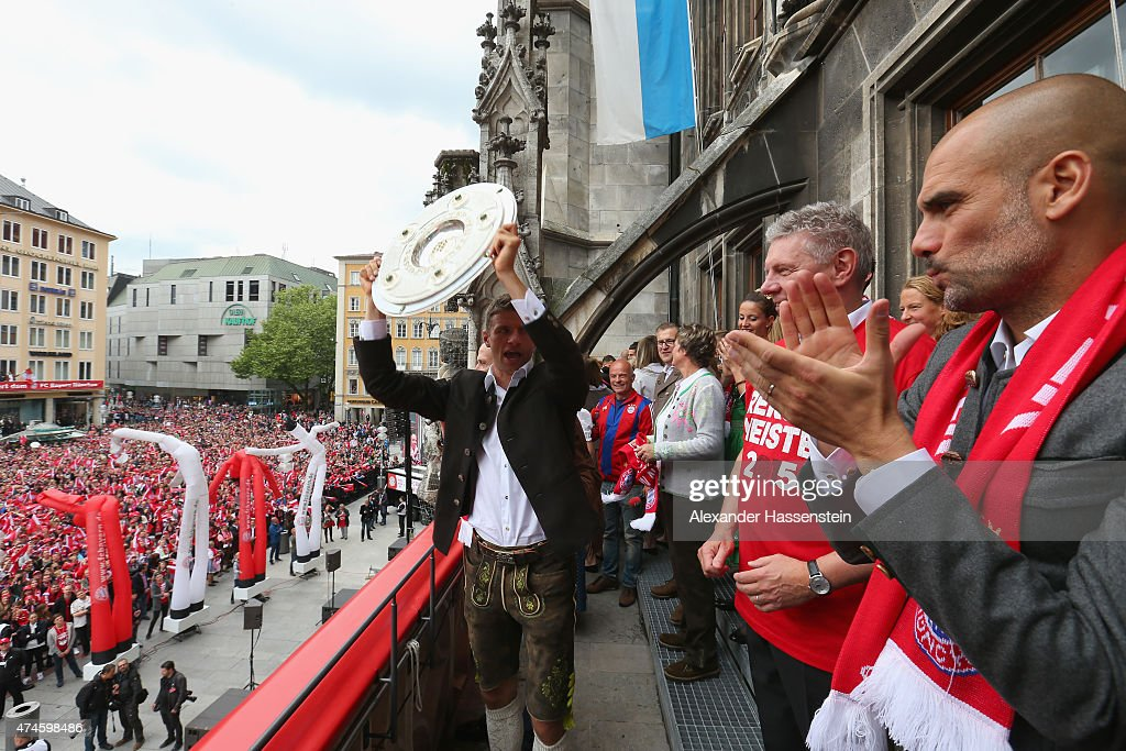 Thomas Mueller of Bayern Muenchen holds the German Championship winners trophy as the team celebrate winning the German Championship title on the town hall balcony at Marienplatz on May 24, 2015 in Munich, Germany.