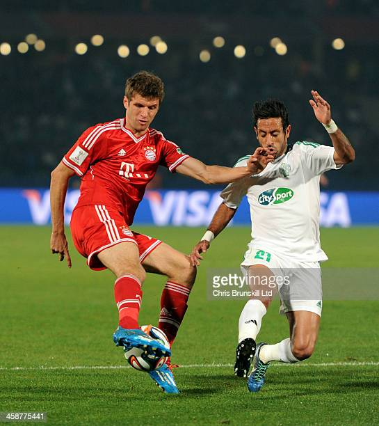 Thomas Mueller of Bayern Muenchen in action with Adil Karrouchy of Raja Casablanca during the FIFA Club World Cup Final match between Bayern Muenchen...