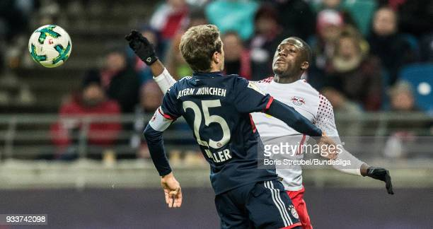 Thomas Mueller of Bayern Muenchen in action with Dato Upamecano of RB Leipzig during the Bundesliga match between RB Leipzig and FC Bayern Muenchen...