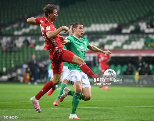 Thomas Mueller of Bayern Muenchen is challenged by Niklas Moisander of Bremen during the Bundesliga match between SV Werder Bremen and FC Bayern...
