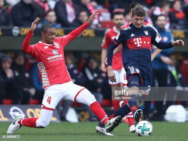 Thomas Mueller of Bayern Muenchen is chased by Abdou Diallo of Mainz during the Bundesliga match between 1 FSV Mainz 05 and FC Bayern Muenchen at...