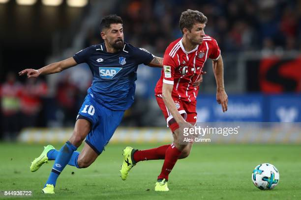 Thomas Mueller of Bayern Muenchen is chased by Kerem Demirbay of Hoffenheim during the Bundesliga match between TSG 1899 Hoffenheim and FC Bayern...