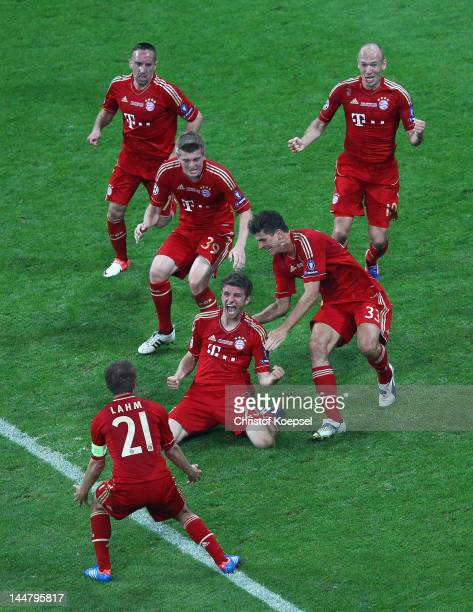 Thomas Mueller of Bayern Muenchen is congratulated team mates after scoring the opening goal during UEFA Champions League Final between FC Bayern...