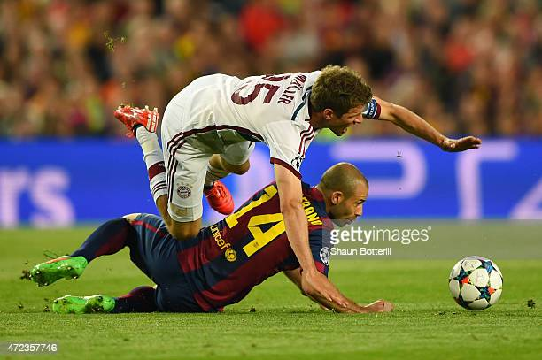 Thomas Mueller of Bayern Muenchen is tackled by Javier Mascherano of Barcelona during the UEFA Champions League Semi Final first leg match between FC...
