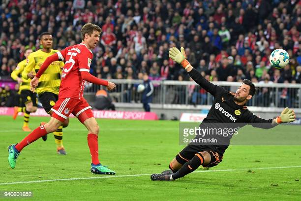Thomas Mueller of Bayern Muenchen l scores a goal past goalkeeper Roman Buerki of Dortmund to make it 30 during the Bundesliga match between FC...