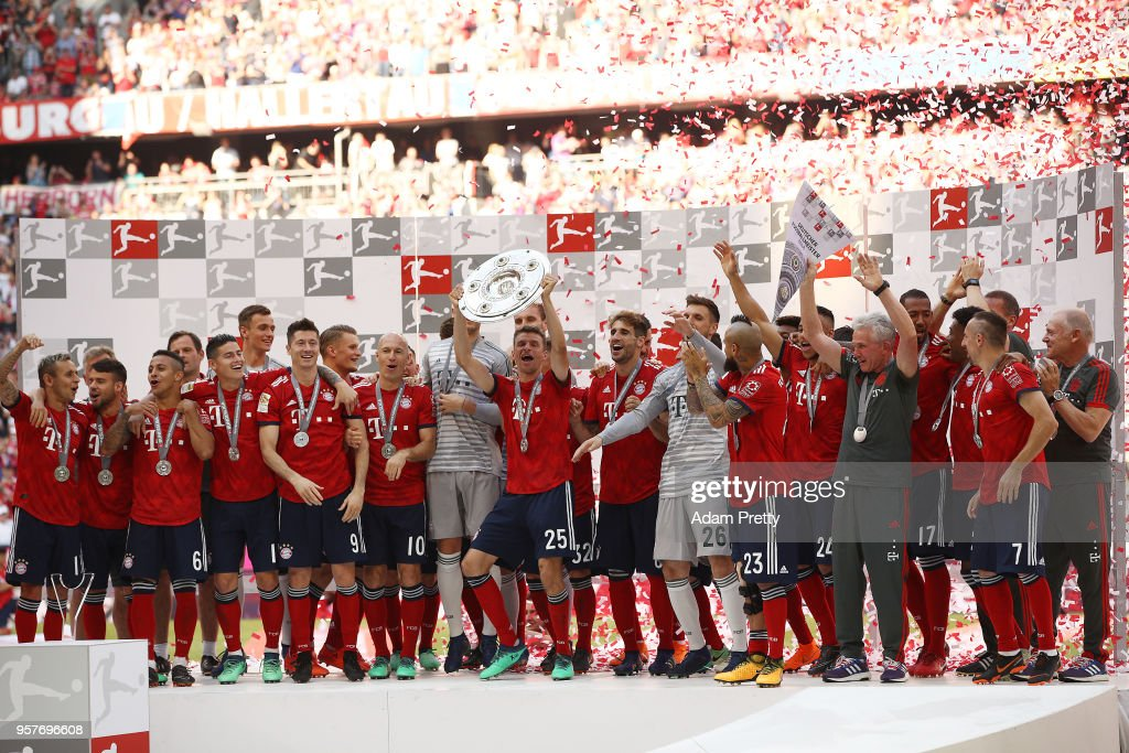 Thomas Mueller of Bayern Muenchen lifts the Bundesliga champions trophy after the Bundesliga match between FC Bayern Muenchen and VfB Stuttgart at Allianz Arena on May 12, 2018 in Munich, Germany.