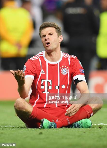 Thomas Mueller of Bayern Muenchen looks dejected as they fail to reach the final after the UEFA Champions League Semi Final Second Leg match between...