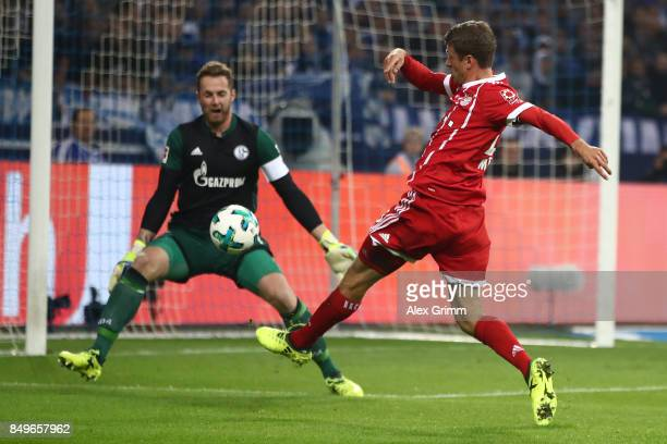 Thomas Mueller of Bayern Muenchen misses a chance against goalkeeper Ralf Faehrmann of Schalke during the Bundesliga match between FC Schalke 04 and...