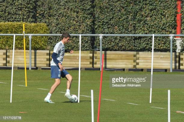 Thomas Mueller of Bayern Muenchen plays the ball during a training session at Saebener Strasse training ground on April 06 2020 in Munich Germany