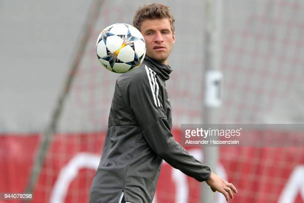 Thomas Mueller of Bayern Muenchen plays with the ball during a Bayern Muenchen training session ahead of the UEFA Champions League 2nd leg...