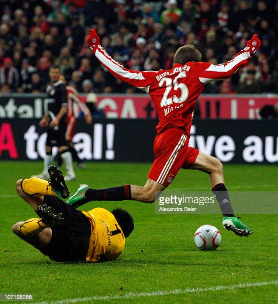 Thomas Mueller of Bayern Muenchen prepares to score his team's second goal after goalkeeper Ola Nikolov of Frankfurt missed to save a shot during the...