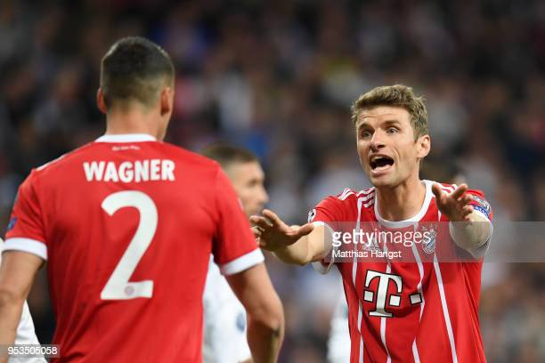 Thomas Mueller of Bayern Muenchen reacts towards team mate Sandro Wagner of Bayern Muenchen during the UEFA Champions League Semi Final Second Leg...