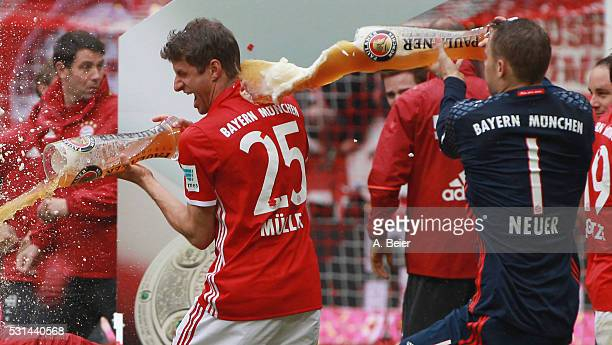 Thomas Mueller of Bayern Muenchen receives a beer shower from his teammate and goalkeeper Manuel Neuer during the German Championship celebration...