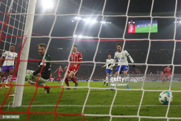 Thomas Mueller of Bayern Muenchen scores a goal past goalkeeper Ralf Faehrmann of Schalke to make it 21 during the Bundesliga match between FC Bayern...