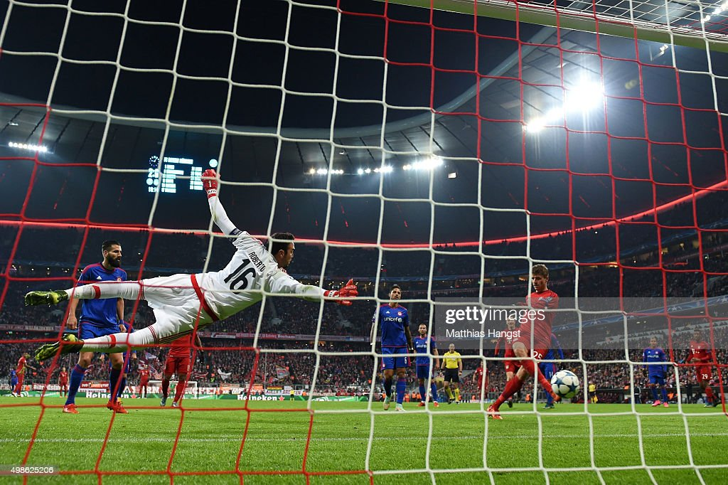 Thomas Mueller of Bayern Muenchen scores Bayern's third goal during the UEFA Champions League group F match between FC Bayern Munchen and Olympiacos FC at the Allianz Arena on November 24, 2015 in Munich, Germany.