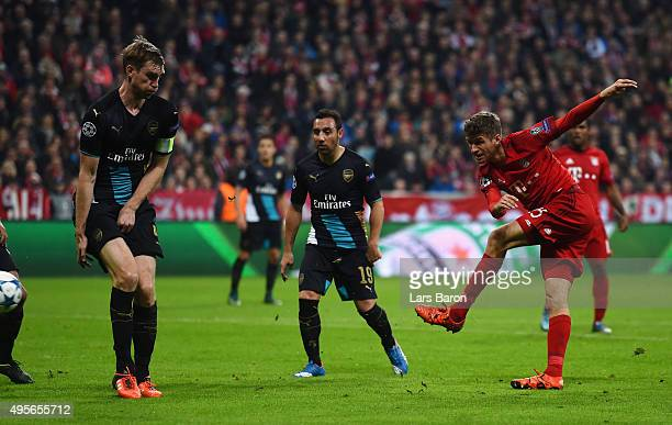 Thomas Mueller of Bayern Muenchen scores his side's second goal during the UEFA Champions League Group F match between FC Bayern Muenchen and Arsenal...