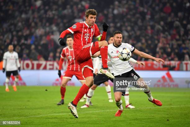 Thomas Mueller of Bayern Muenchen scores his sides third goal during the UEFA Champions League Round of 16 First Leg match between Bayern Muenchen...