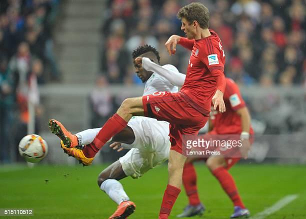 Thomas Mueller of Bayern Muenchen scores his team's third goal against Papy Djilobodji of Werder Bremen during the Bundesliga match between FC Bayern...