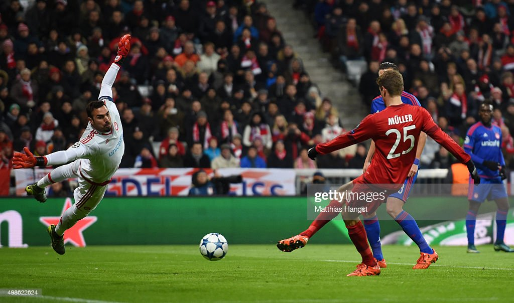 Thomas Mueller of Bayern Muenchen scores his teams third goal during the UEFA Champions League group F match between FC Bayern Munchen and Olympiacos FC at the Allianz Arena on November 24, 2015 in Munich, Germany.