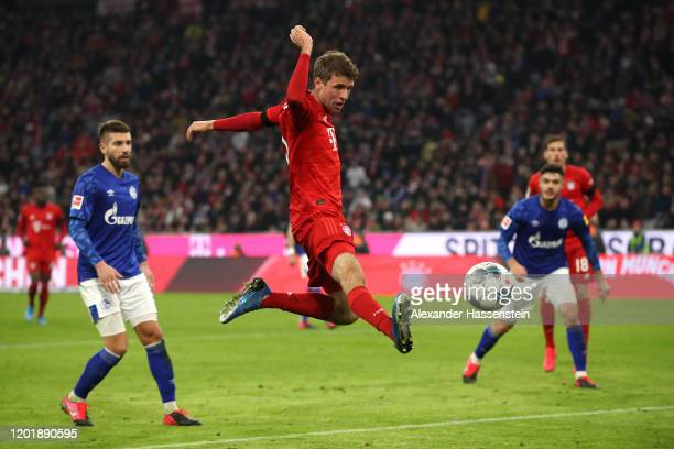 Thomas Mueller of Bayern Muenchen scores the 2nd team goal during the Bundesliga match between FC Bayern Muenchen and FC Schalke 04 at Allianz Arena...