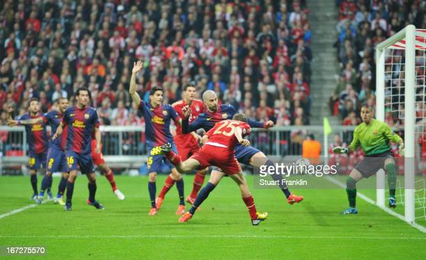 Thomas Mueller of Bayern Muenchen scores the opening goal during the UEFA Champions League Semi Final First Leg match between FC Bayern Muenchen and...