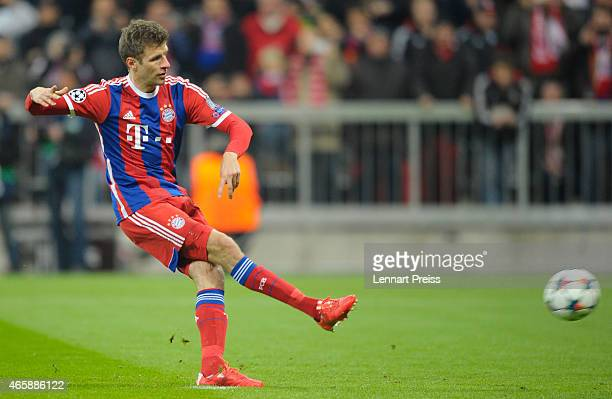 Thomas Mueller of Bayern Muenchen scores the opening goal with a penalty during the UEFA Champions League Round of 16 second leg match between FC...