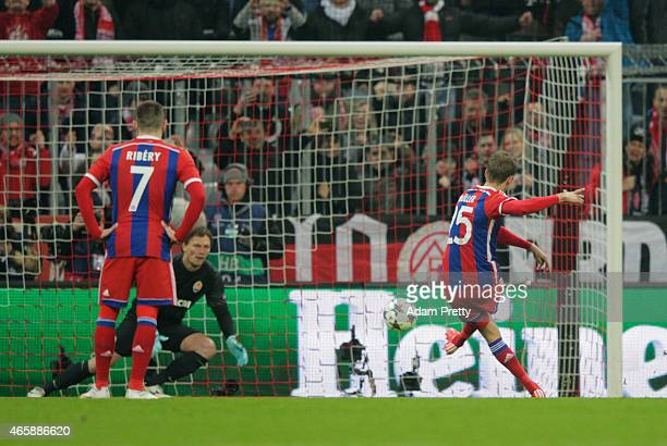 Thomas Mueller of Bayern Muenchen scores their first goal from a penalty past goalkeeper Andriy Pyatov of Shakhtar Donetsk during the UEFA Champions...