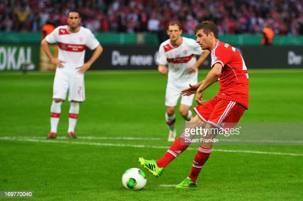Thomas Mueller of Bayern Muenchen scores their first goal from the penalty spot during the DFB Cup Final match between FC Bayern Muenchen and VfB...