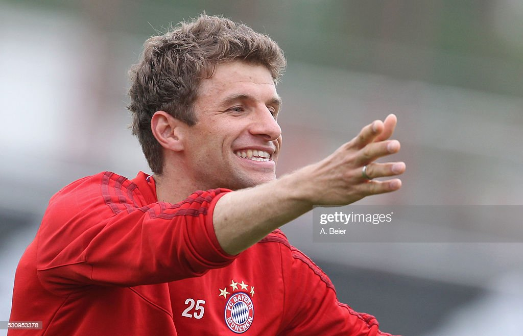 Thomas Mueller of Bayern Muenchen smiles during a training session at FC Bayern Muenchen training ground on May 12, 2016 in Munich, Germany.