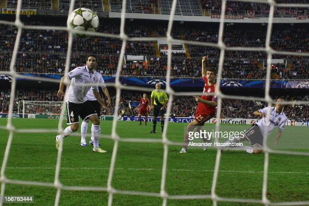Thomas Mueller of Bayern Muenchenscores the first team goal during the UEFA Champions League group F match between Valencia FC and FC Bayern Muenchen...