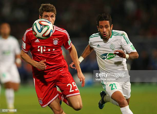 Thomas Mueller of Bayern Munich and Adil Karrouchy of Raja Casablanca