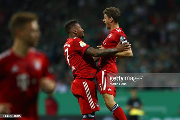 Thomas Mueller of Bayern Munich and Jerome Boateng of Bayern Munich celebrate after team scored the first goal during the DFB Cup semi final match...