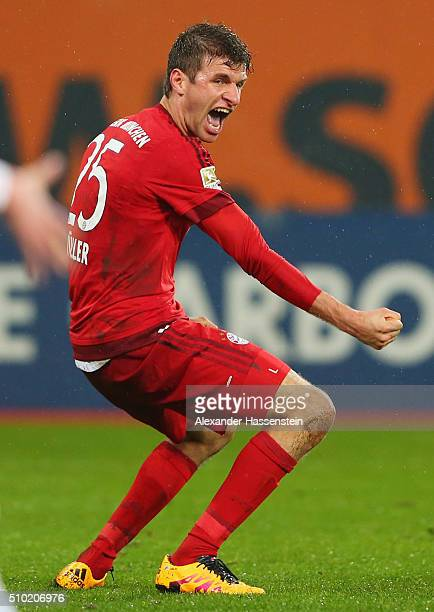 Thomas Mueller of Bayern Munich as he scores their third goal during the Bundesliga match between FC Augsburg and FC Bayern Muenchen at SGL Arena on...