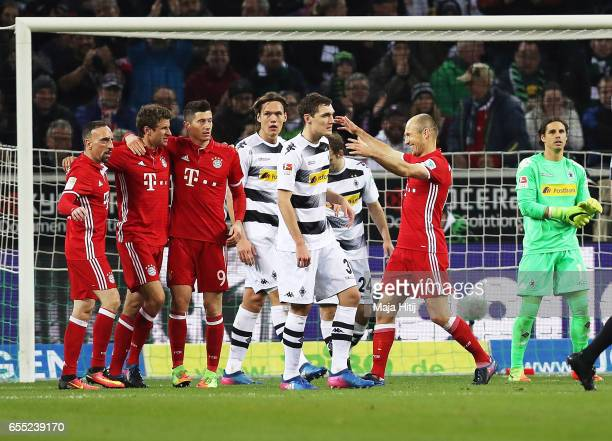 Thomas Mueller of Bayern Munich celebrates after scoring a goal while Yann Sommer of Borussia Moenchengladbach is dejected during the Bundesliga...