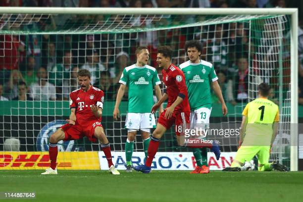 Thomas Mueller of Bayern Munich celebrates after scoring his team's second goal during the DFB Cup semi final match between Werder Bremen and FC...