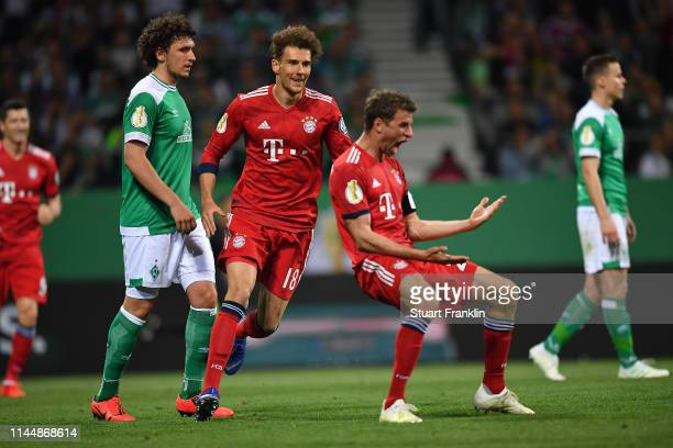 Thomas Mueller of Bayern Munich celebrates after scoring his team's second goal with Leon Goretzka of Bayern Munich during the DFB Cup semi final...