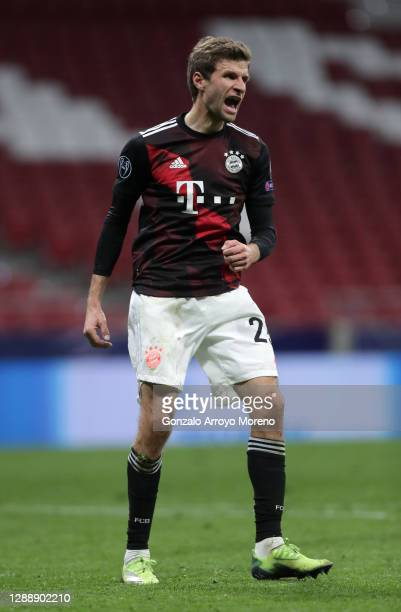 Thomas Mueller of Bayern Munich celebrates after scoring their team's first goal from the penalty spot during the UEFA Champions League Group A stage...
