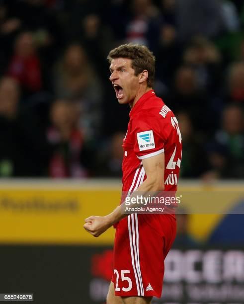 Thomas Mueller of Bayern Munich celebrates scoring a goal during the Bundesliga Match between Borussia Moenchengladbach and Bayern Munich at...
