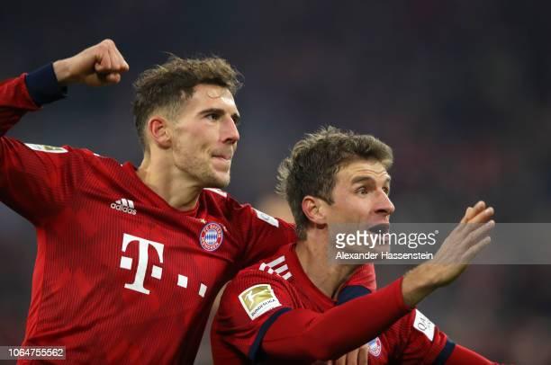Thomas Mueller of Bayern Munich celebrates with teammate Leon Goretzka after scoring his team's third goal during the Bundesliga match between FC...