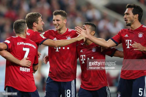 Thomas Mueller of Bayern Munich celebrates with teammates after scoring his team's third goal during the Bundesliga match between VfB Stuttgart and...
