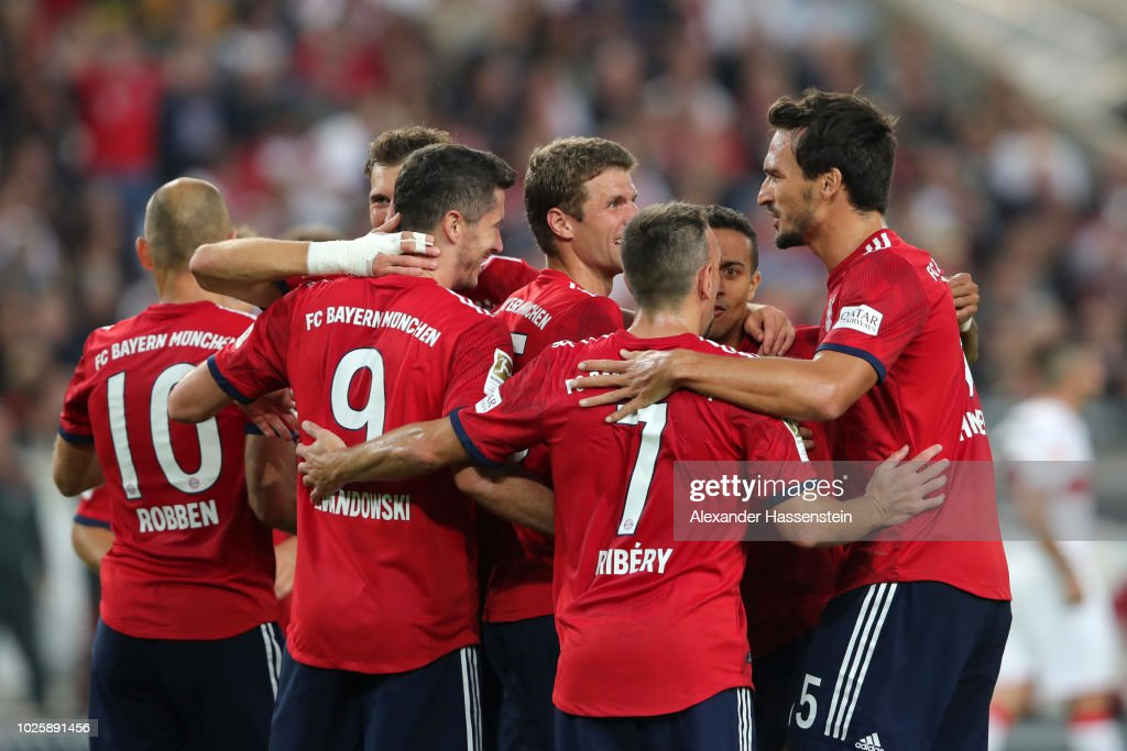 Thomas Mueller of Bayern Munich celebrates with teammates after scoring his team's third goal during the Bundesliga match between VfB Stuttgart and FC Bayern Muenchen at Mercedes-Benz Arena on September 1, 2018 in Stuttgart, Germany.