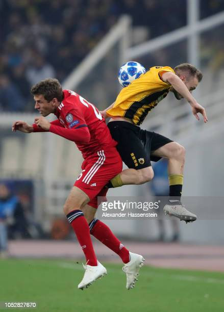 Thomas Mueller of Bayern Munich challenges for the ball with with Michalis Bakakis of AEK Athens during the Group E match of the UEFA Champions...