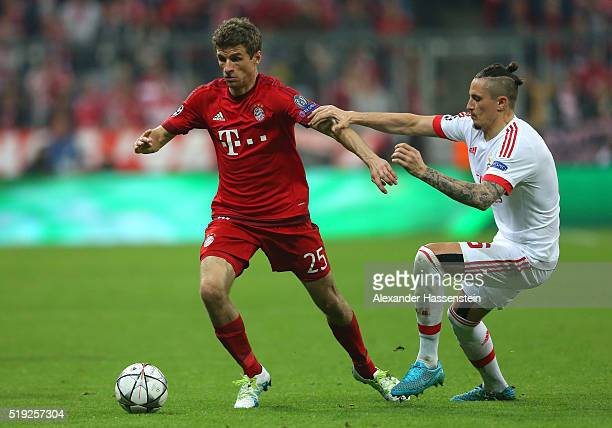 Thomas Mueller of Bayern Munich holds off Ljubomir Fejsa of Benfica during the UEFA Champions League quarter final first leg match between FC Bayern...